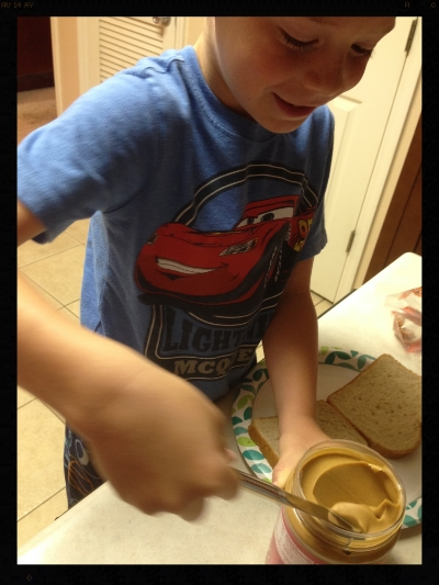 Helping mommy out, making his own sandwich. He was so proud. Such a good little helper!  Got in a little fishing! :) Then, picked some dandelions and made a wish before blowing on the dandelions...... wishing to be back to running in the morning ;)