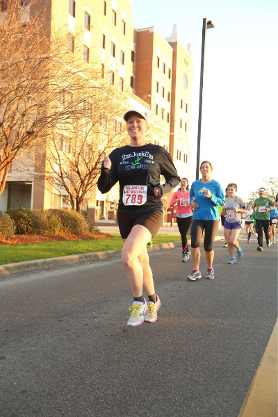 Seriously, my favorite picture! Not because it is the ONE and ONLY running picture that I don't appear to be dying, but that this is the Half Marathon that I PR'D 2/8/2015!!!