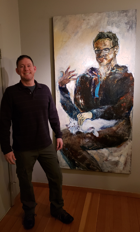 "Mathie standing with ""Petting Kitty In His Velour Onesie,"" 72 x 36 inches."