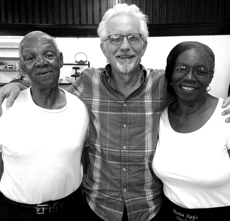 Johnny with owners of Mama Kay's Restaurant. Photo by Jennifer Edmondson.