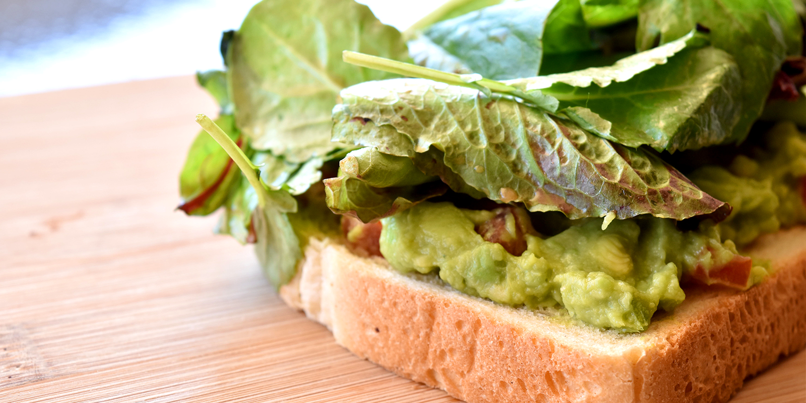Avocado Toast - Avocado, minced Tomato, Topped with Mixed Greens tossed in Balsamic Vinaigrette$7.50