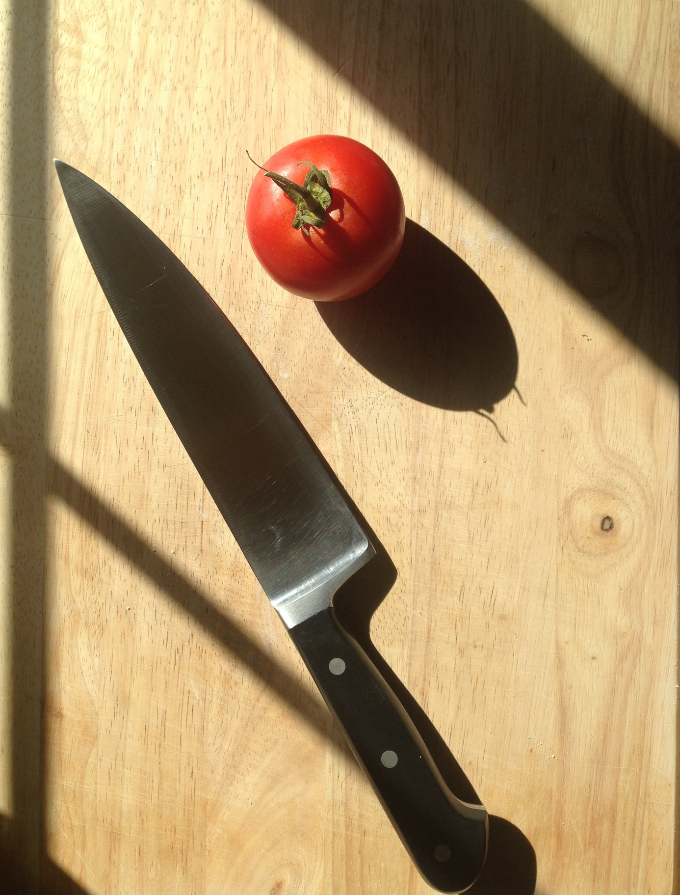 french knife and organic tomato