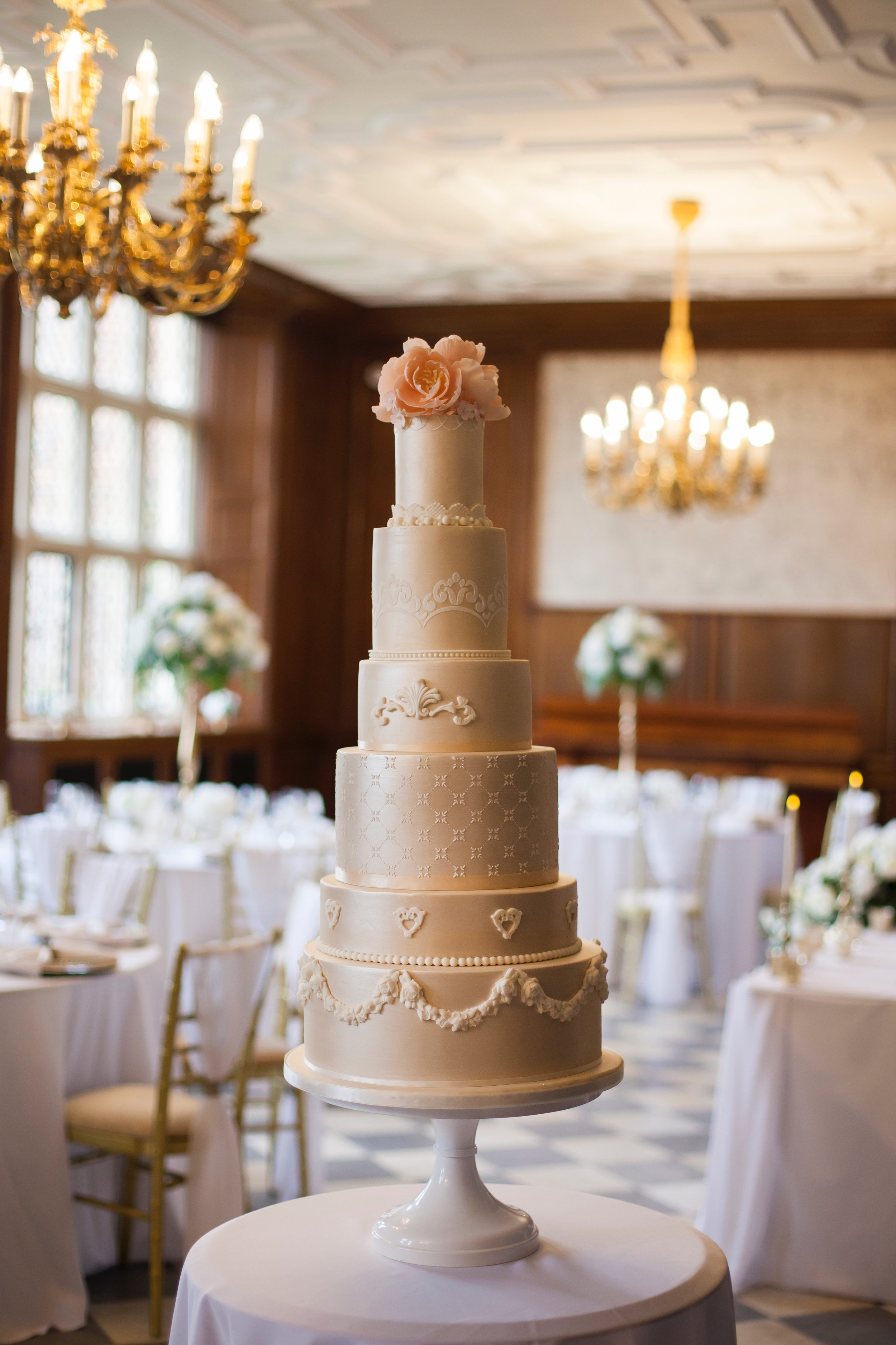 This 6-tiered cake made the perfect masterpiece for the Herfordshire wedding venue North Mymms Park. Photography by  Esme Robinson.