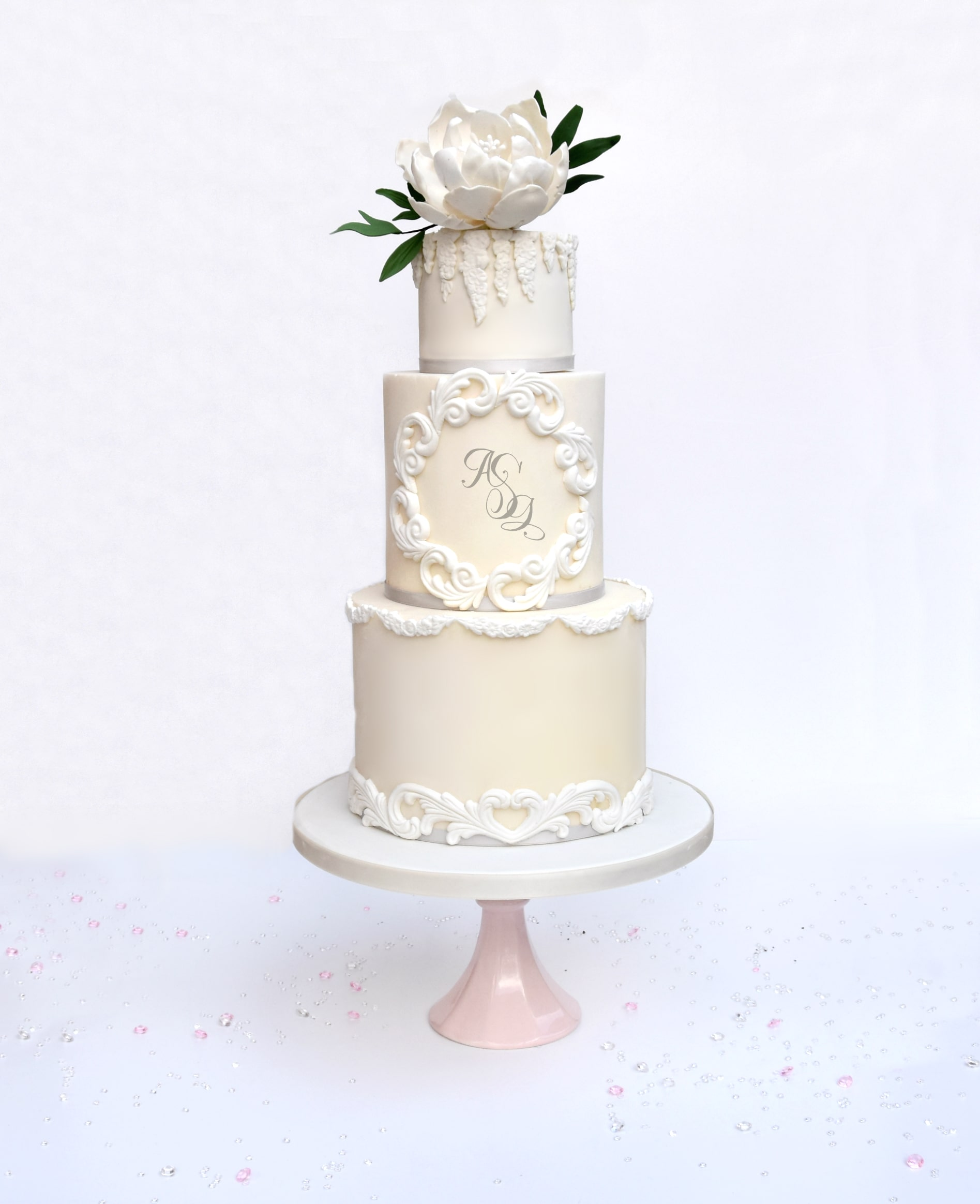 Classic wedding cake design with custom monogram and sugar flower by Meadowsweet Cakes for a Cambridgeshire wedding