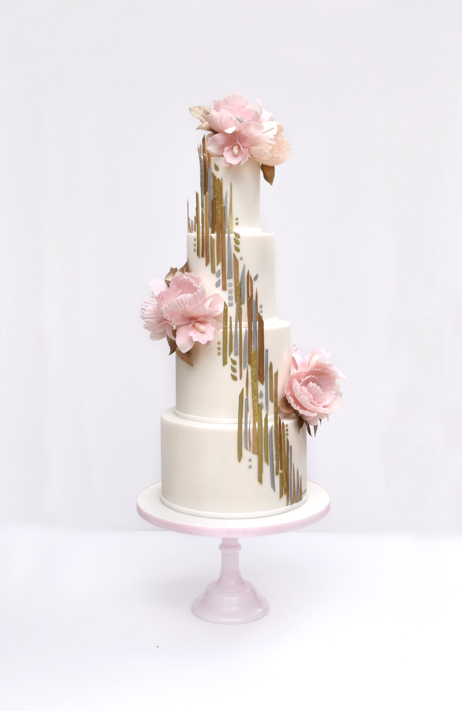 Showstopping Award winning wedding cake design with metallic gold detail and sugar flowers by Meadowsweet Cakes