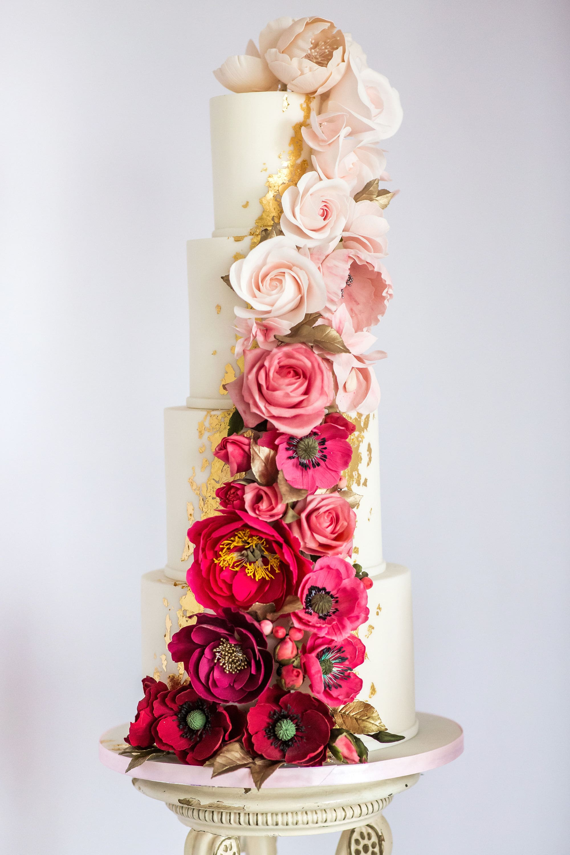 ombre sugar flower cascade on this glamorous showstopper wedding cake by Meadowsweet Cakes, a Hertfordshire wedding cake company. Photography by Rafe Abrook Photography