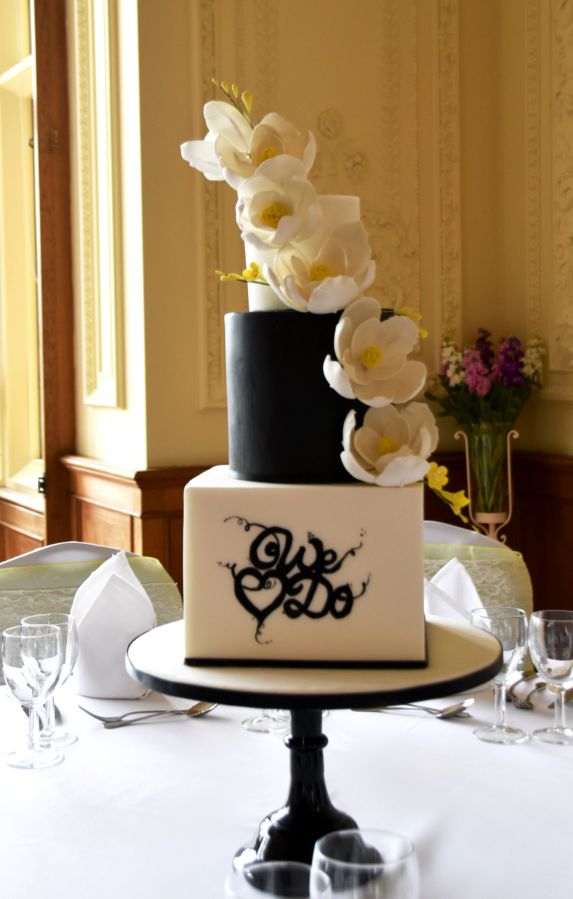 The House Shuttleworth Wedding Cake by Meadowsweet Cakes. Stunning black and white cake with custom calligraphy and sugar flowers