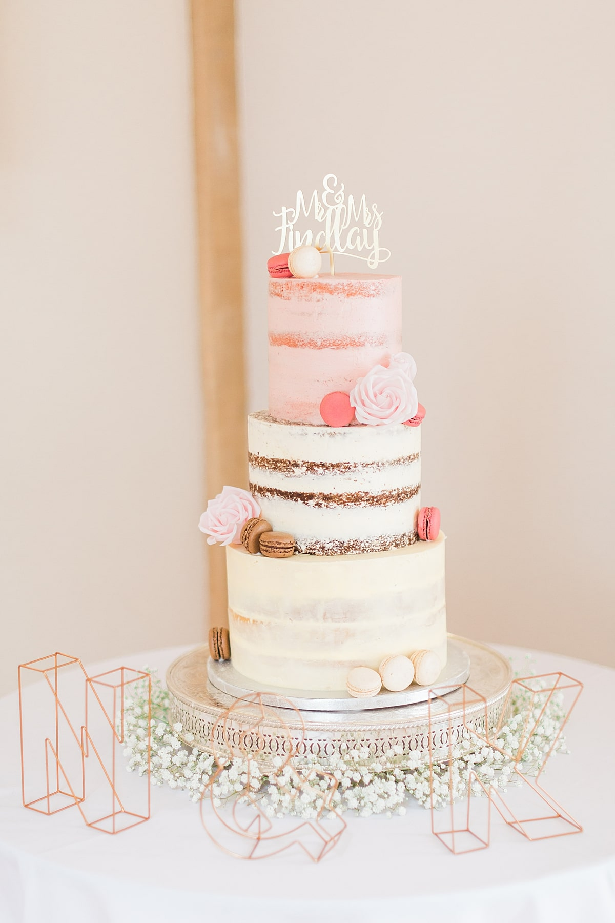 semi naked wedding cake with macarons at Bassmead Manor Barns, by Meadowsweet Cakes