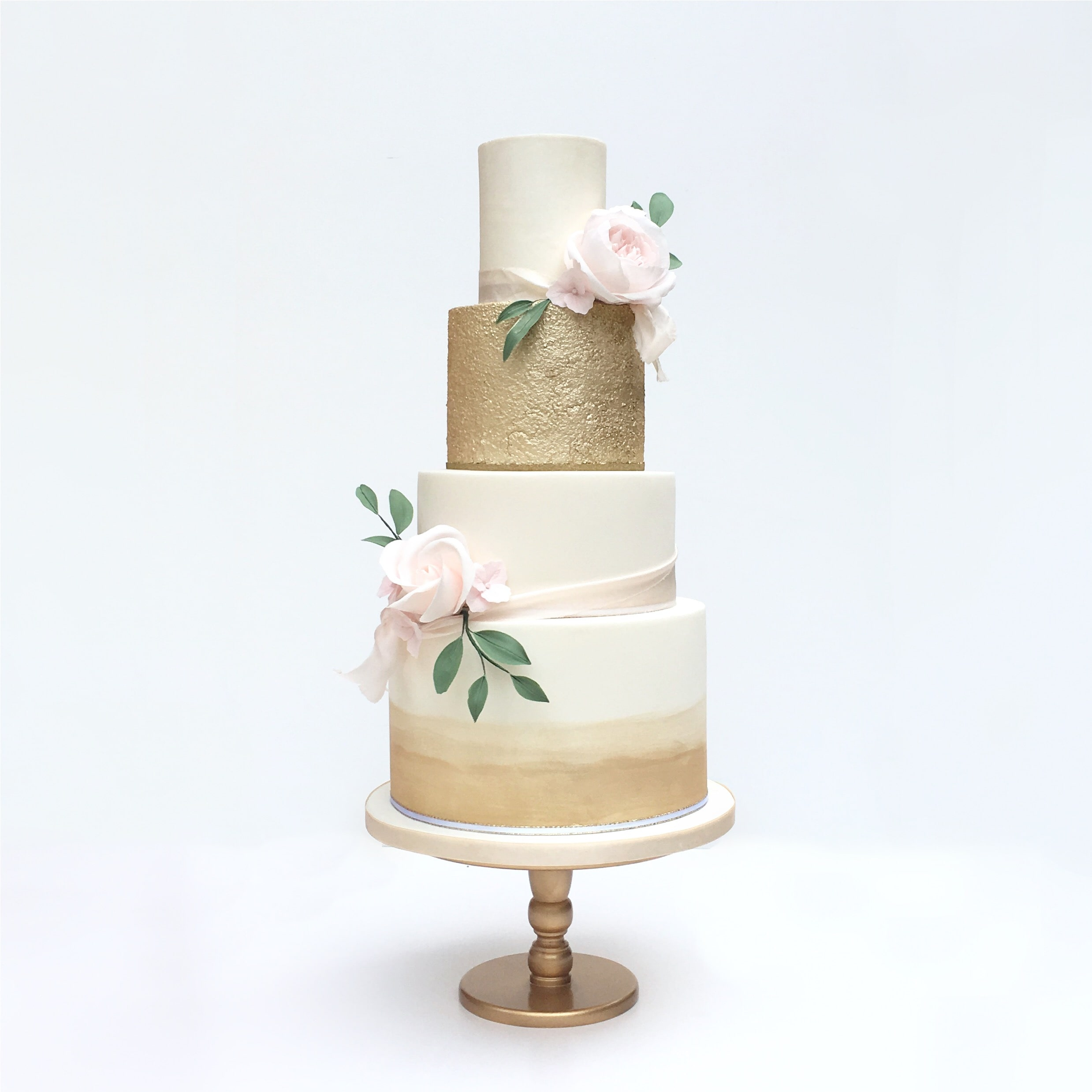 luxury wedding cake in modern gold and blush by Meadowsweet Cakes London wedding cakes