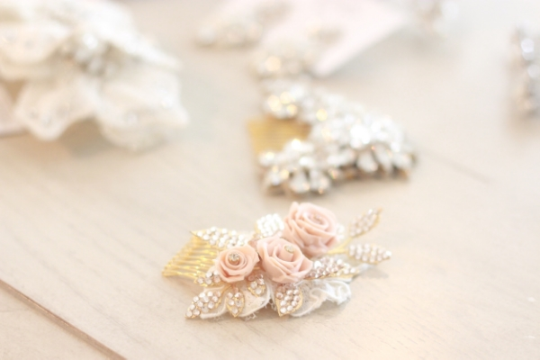 This dusty pink rosette hair comb is a subtle hail to the Bohemian world. It's available at  Posh Bridal  in Wayzata.