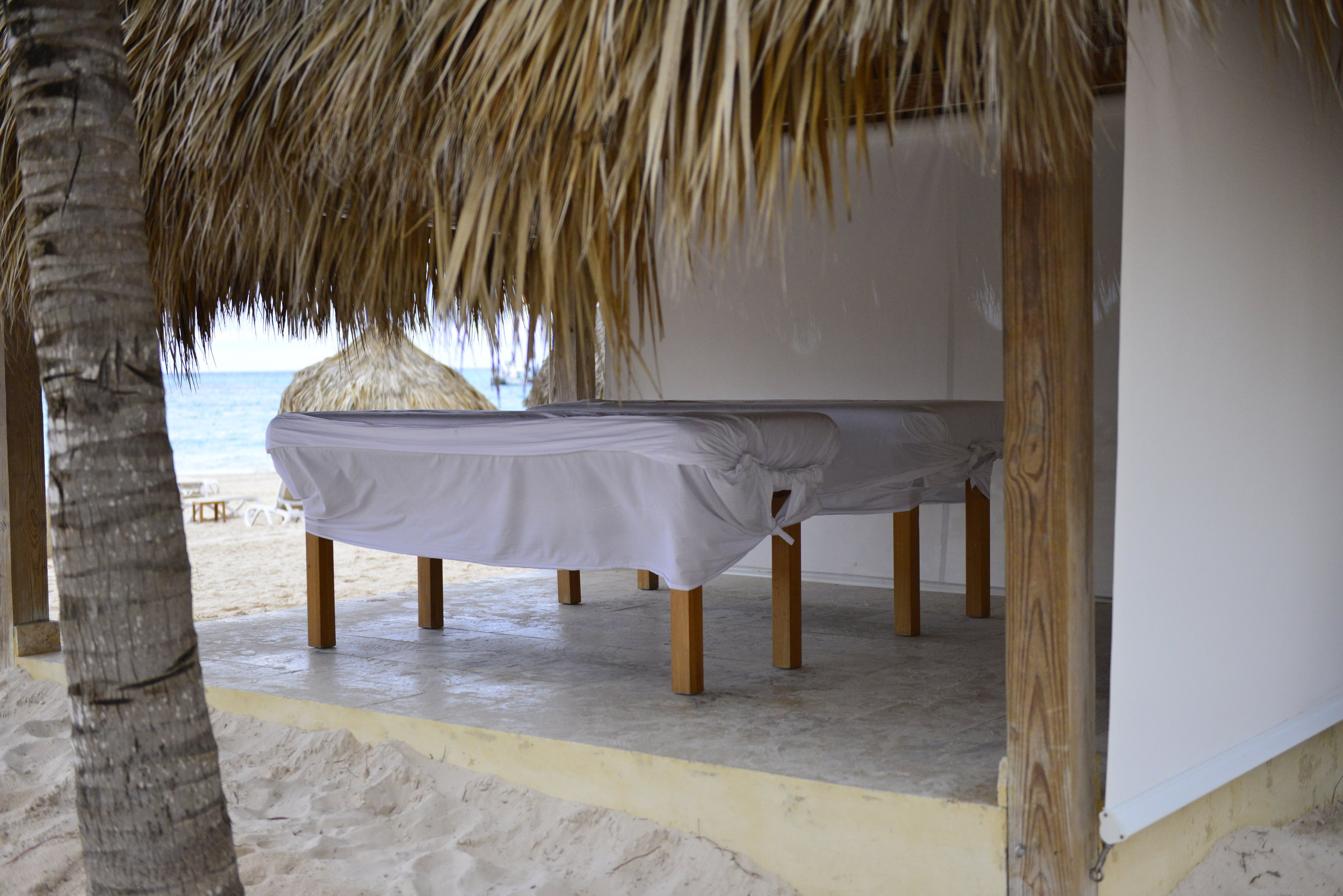 melia caribe tropical punta cana - gorgeous beachside massage tables - dana chirps - adventure blogger