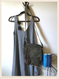 Heather grey sheath dress with sunnies and green tote.