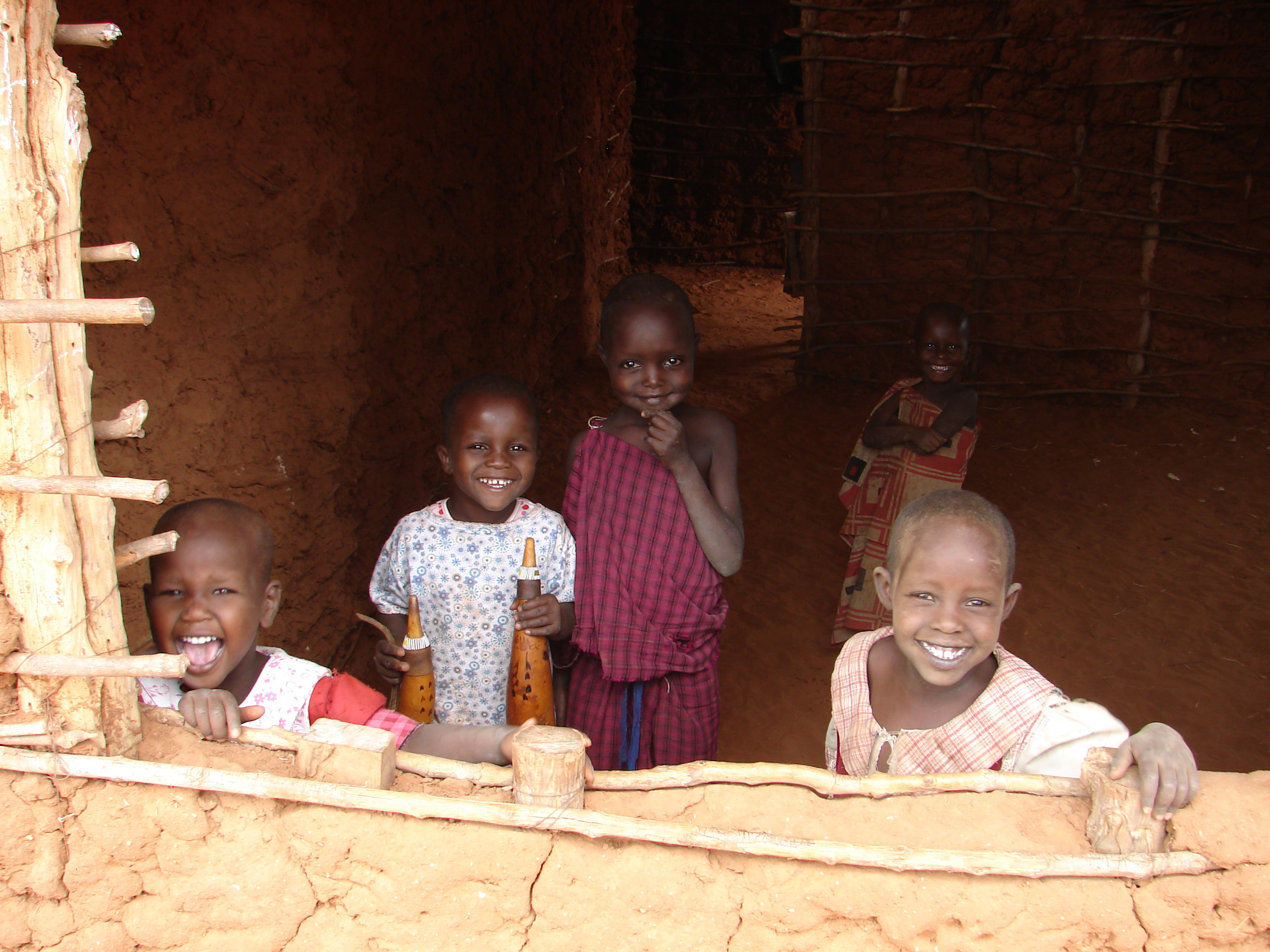 Masai children playing in their family home