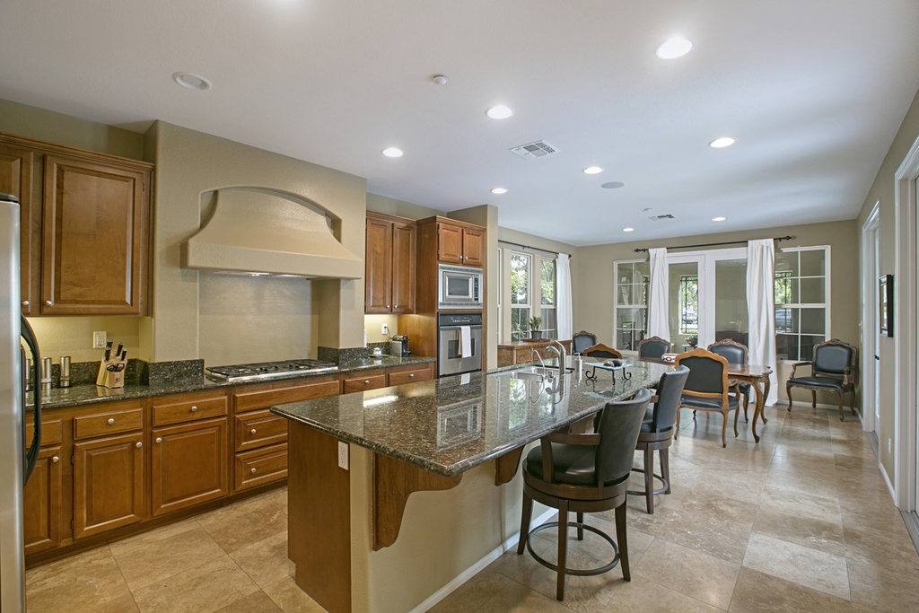 8. Cortilles 2 Plan - Kitchen-Project Delivery Group.jpg
