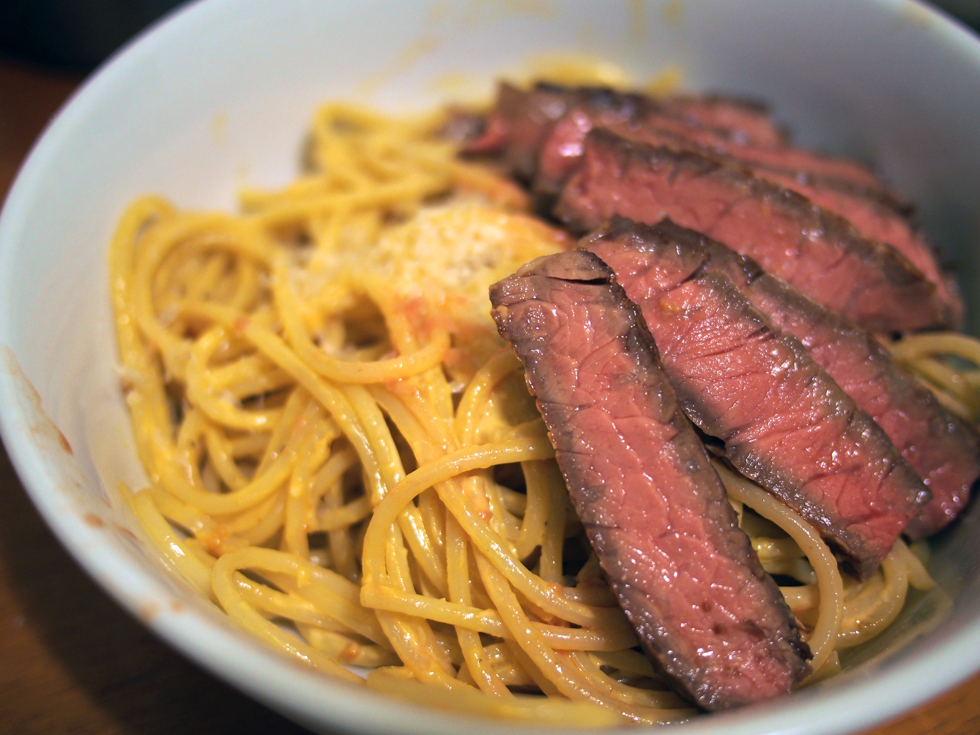 Spaghetti with uni butter, garlic, pepper, and parmigiano-reggiano and sliced pan-seared/butter-basted rib eye!