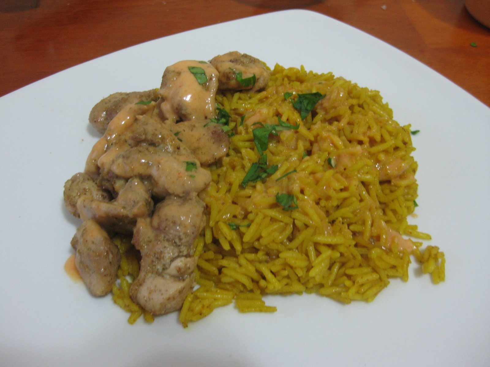 Rice pilaf with sauteed chicken and sriracha creme fraiche, the entree of that dinner.