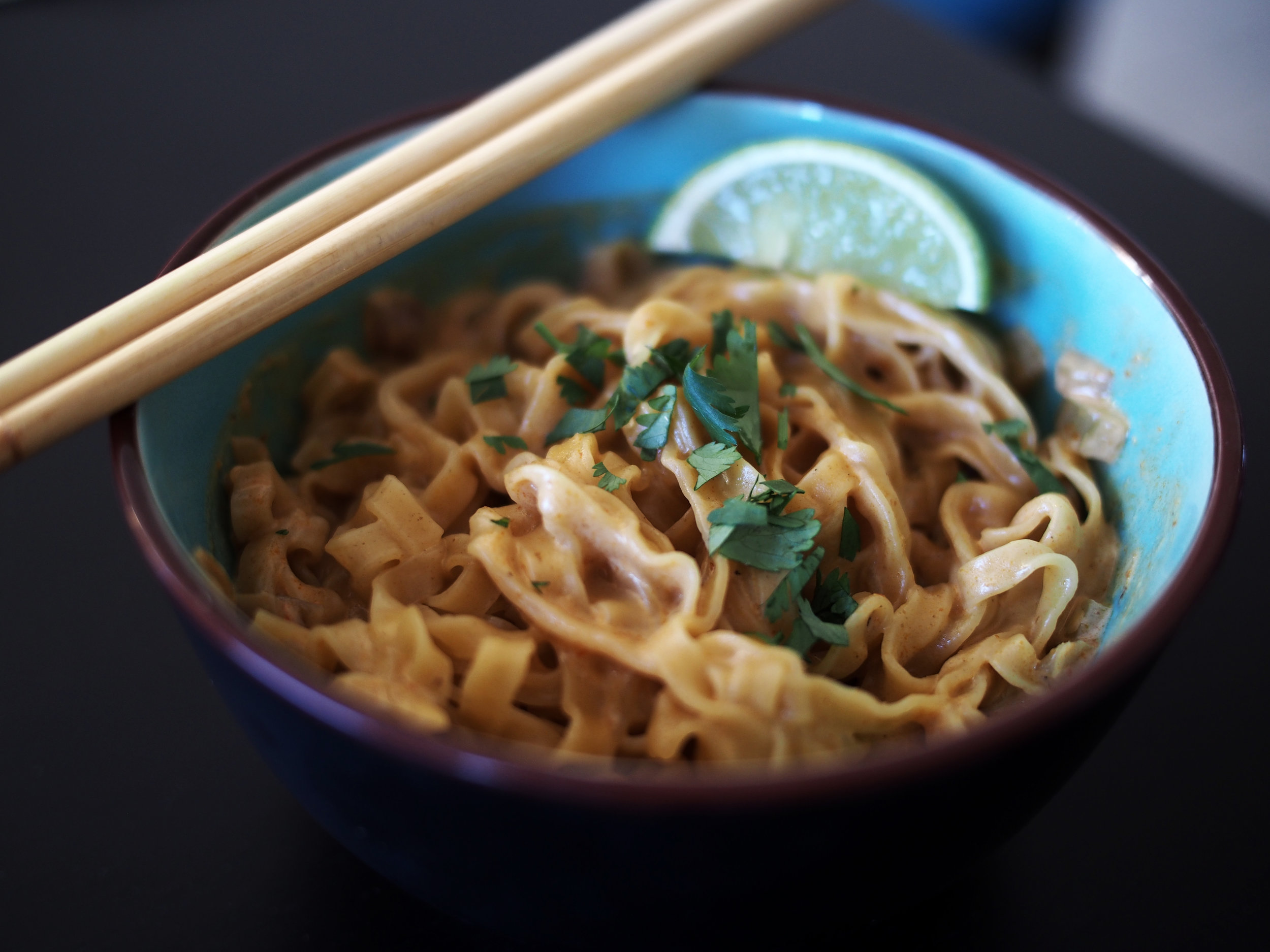 Egg noodles in red curry sauce with lime