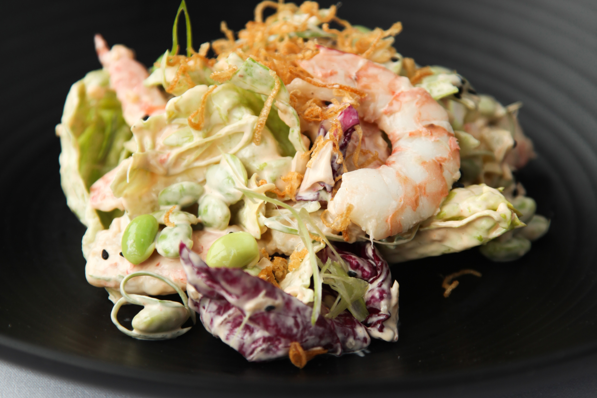 Salad of poached Prawns, iceberg, edamame, spring onion, crispy shallots, Marie Rose dressing & black sesame