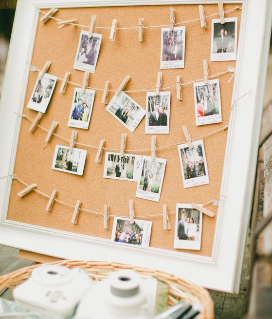 Image via:  Capturing a moment during the reception for a polaroid board will last forever