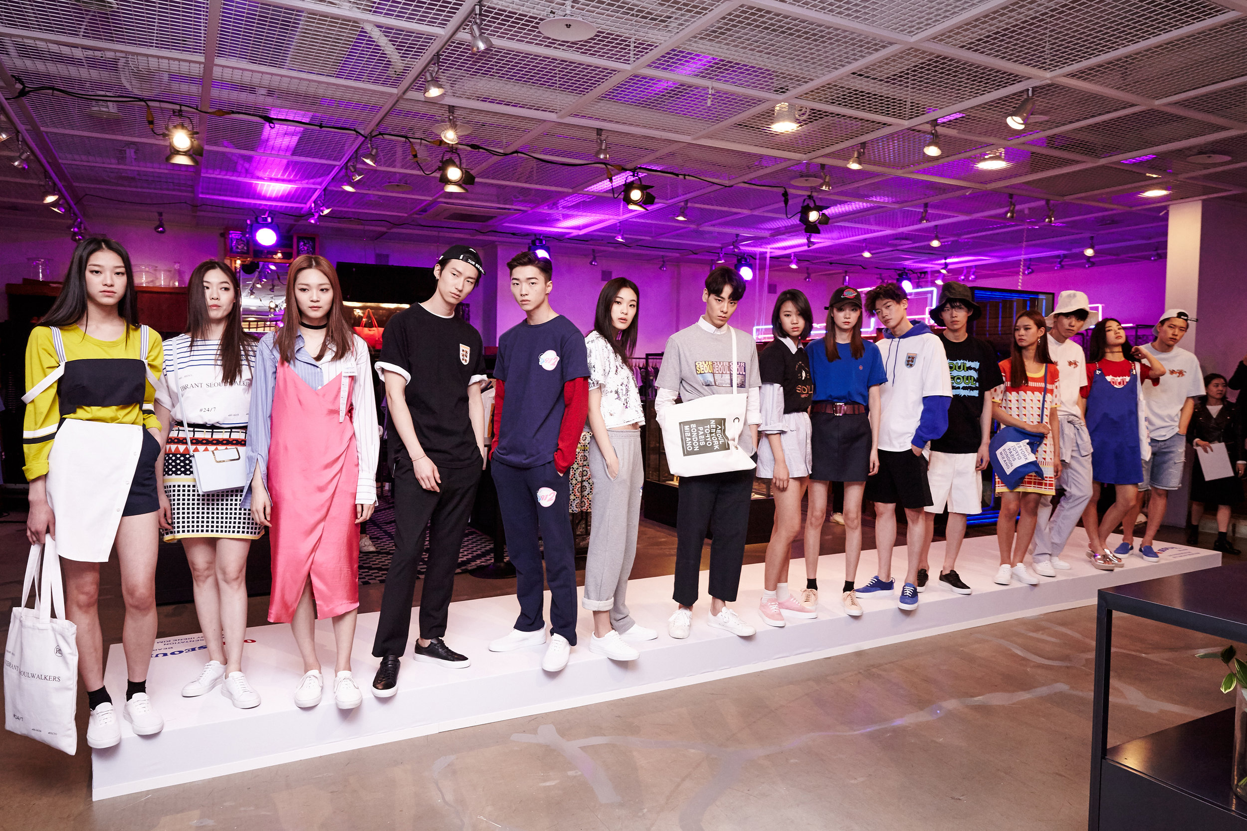 Mini catwalk with models styled by the Korean designers