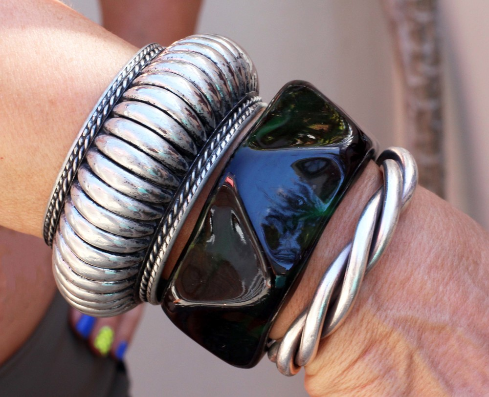I love bangles to liven up an outfit. I found these over the years, cheap as chips, apart from the solid silver one.