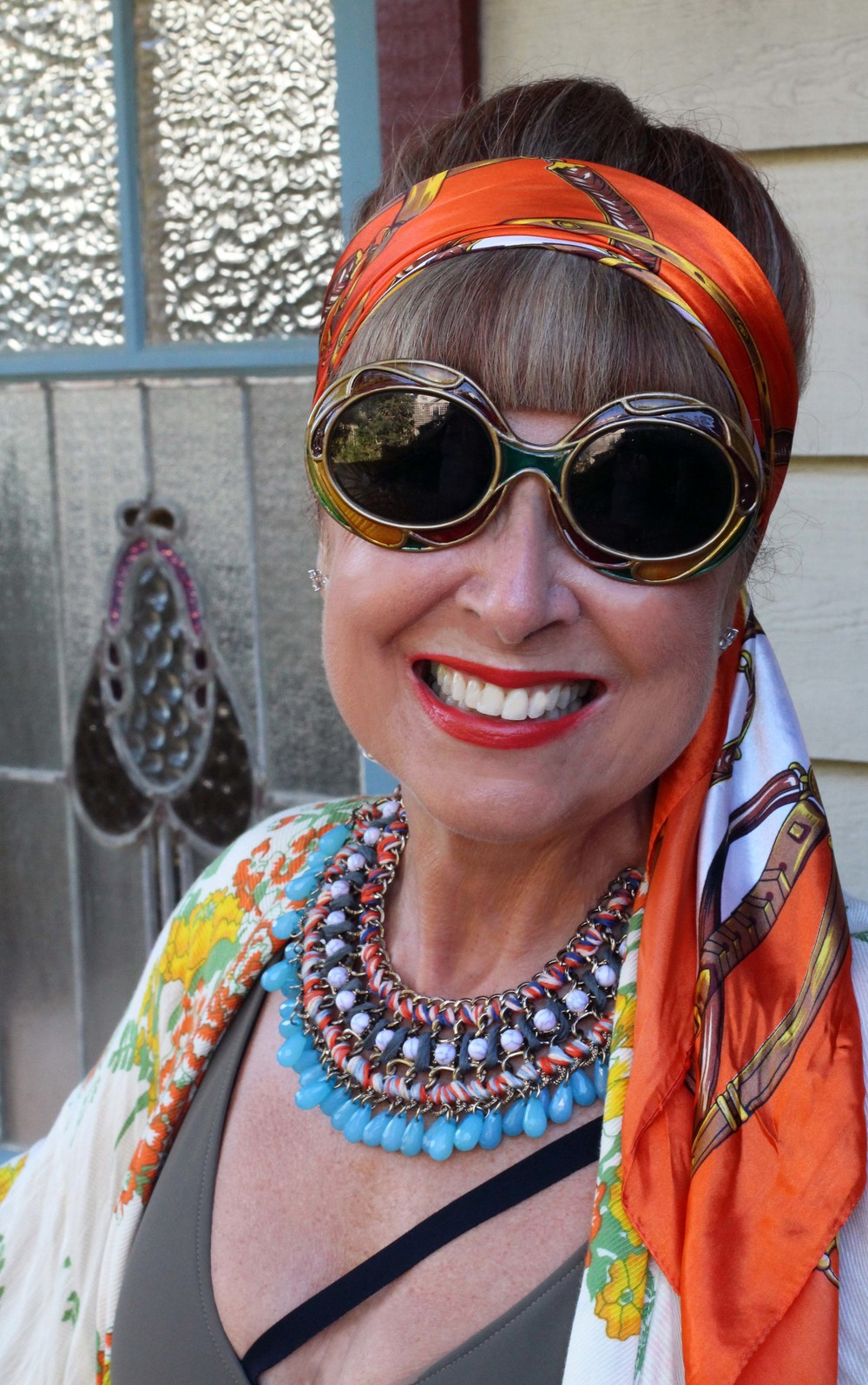 The vibrant silk scarf was bought in Montenegro for a song. The vintage sunglasses are from  Trash  in Byron Bay & the necklace was loaned by my wonderful stylist & Photographer Charlotte,  A Beautiful Weirdo.