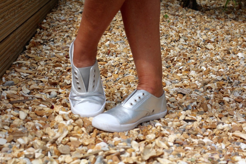 Silver sneakers to dress down a posh outfit.