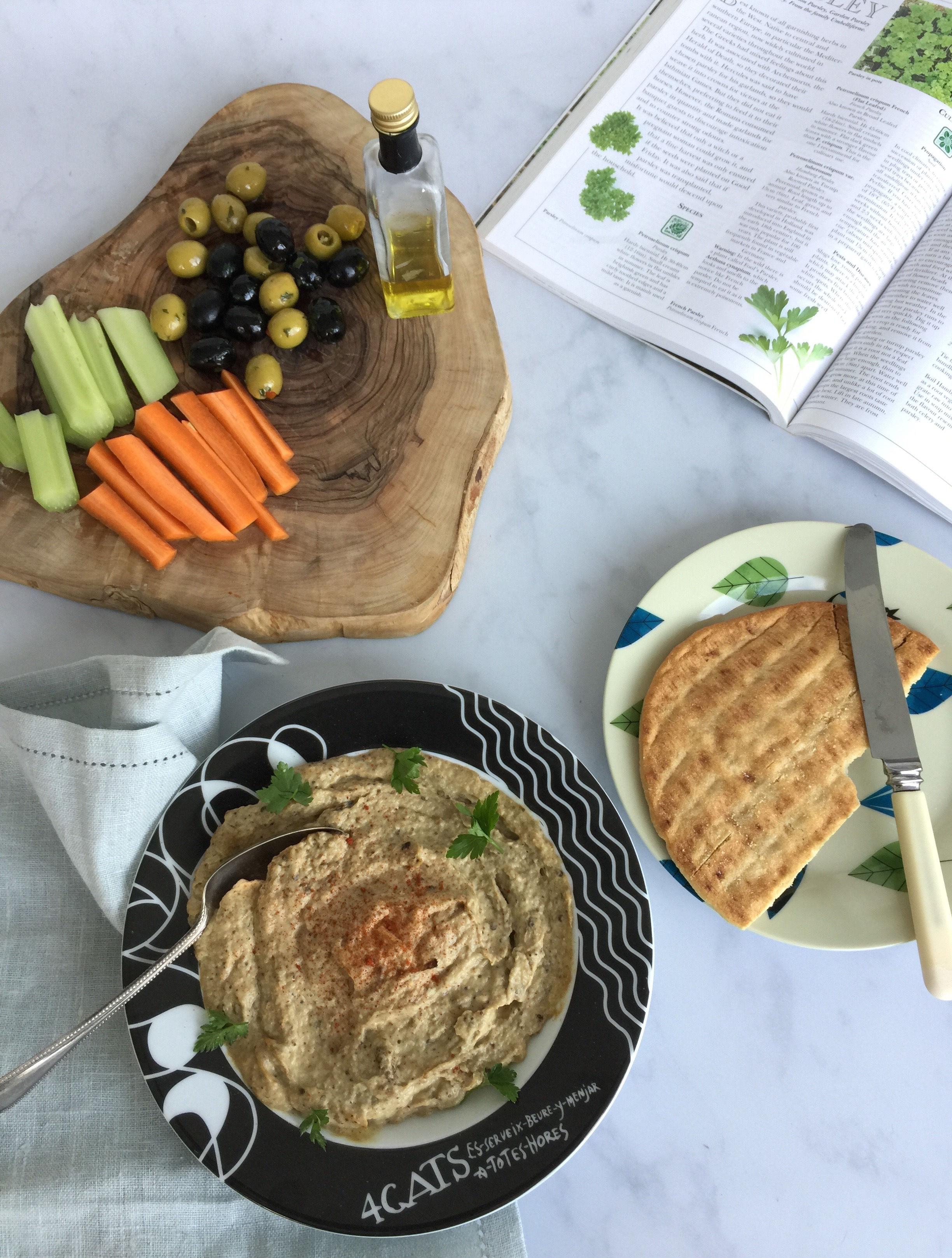 Serve pitta bread, olives & raw veg with a plate of home-made baba ganoush.