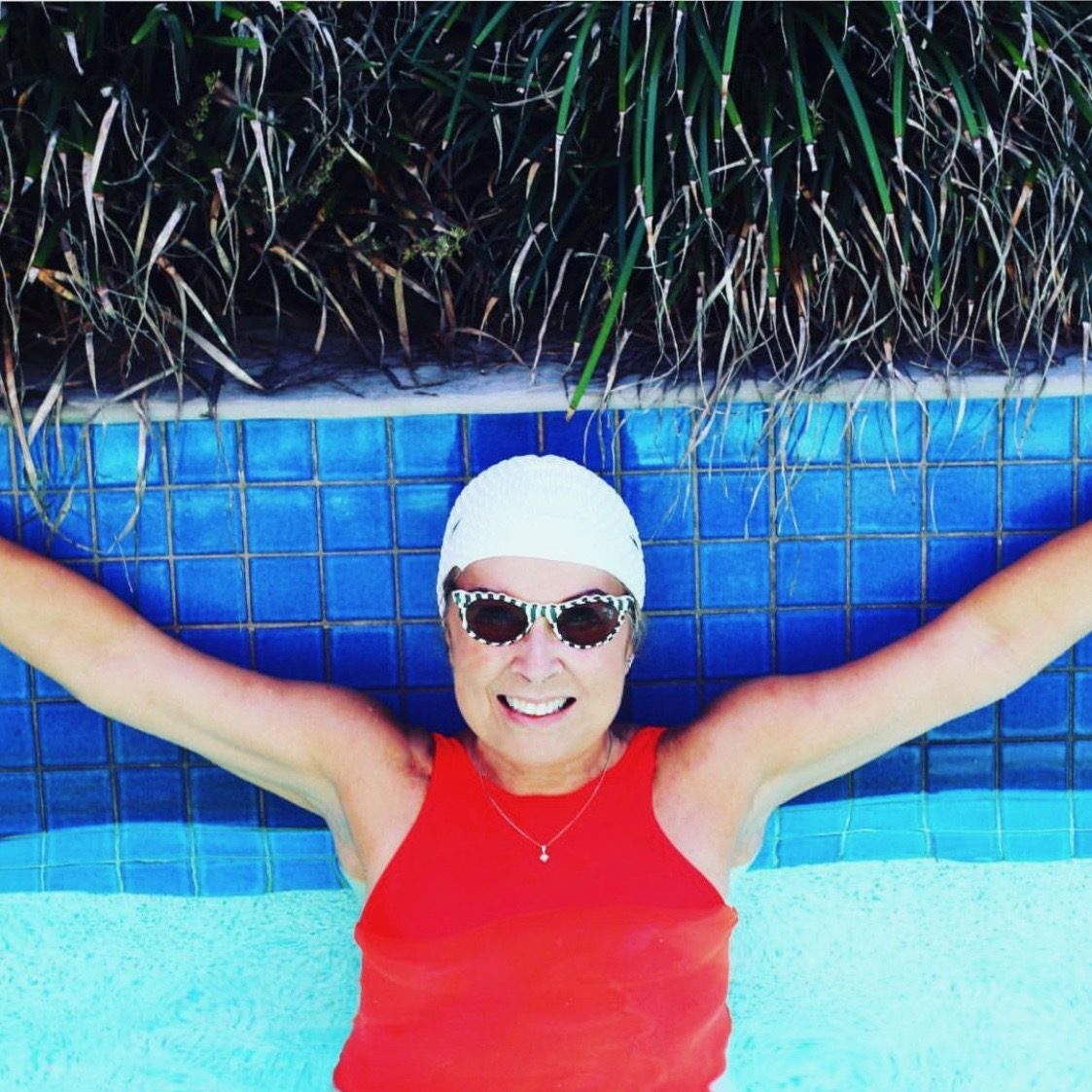 Swimming and posing in Byron Bay