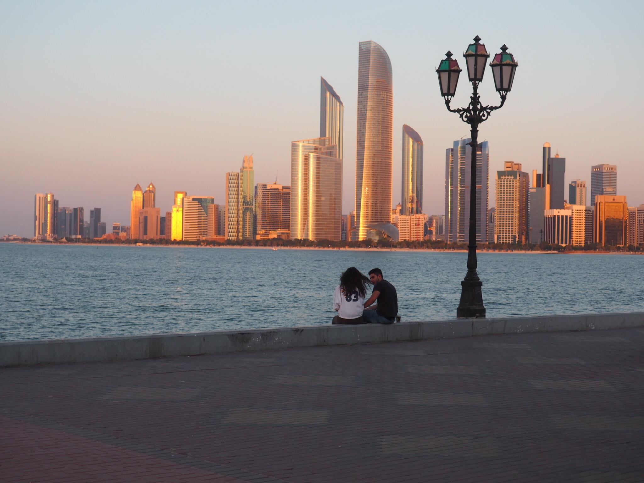 Abu Dhabi skyline at sun set.jpg