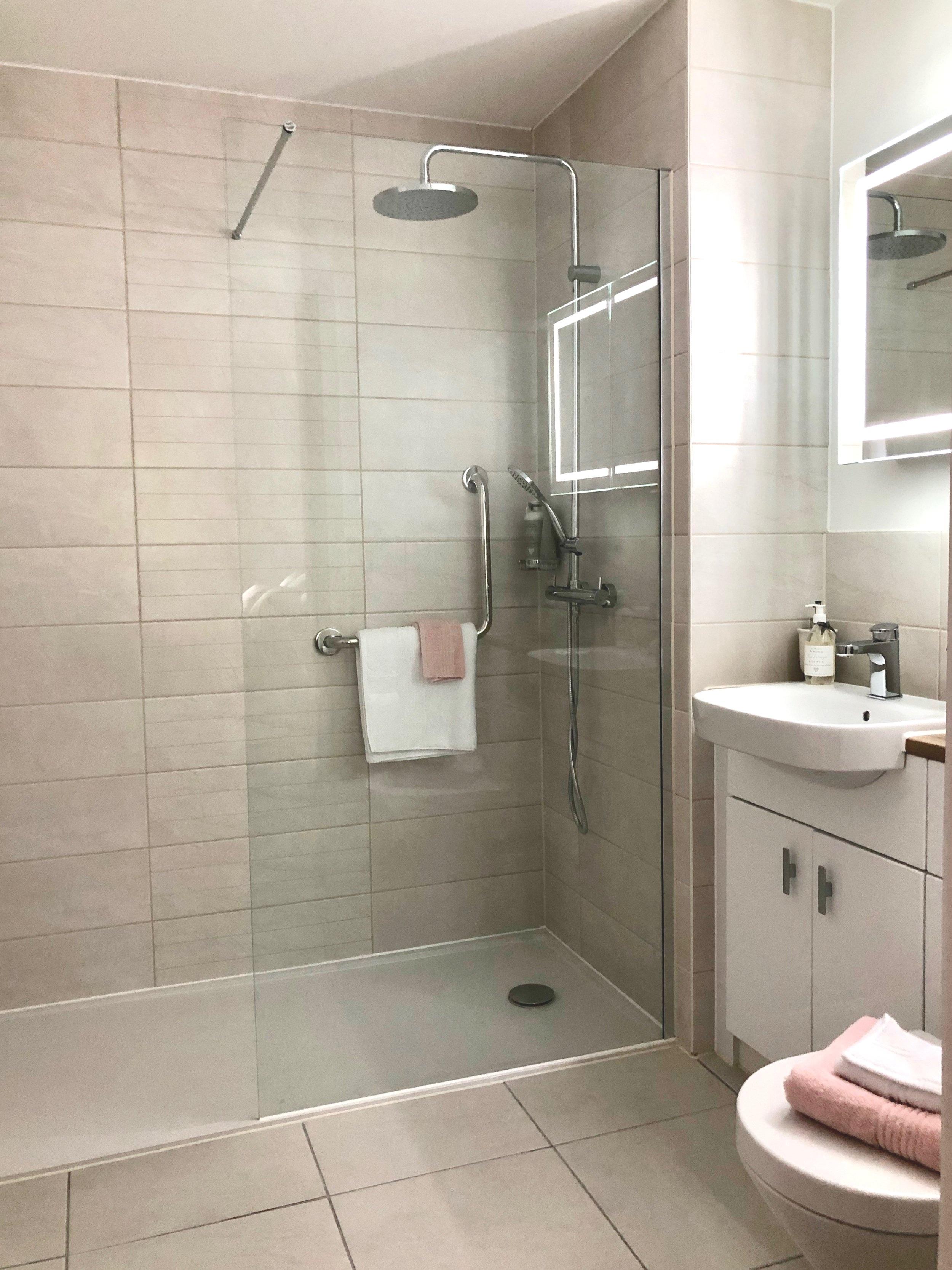 Just love the illuminated mirror & rain shower.
