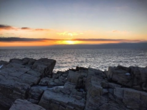 A winter sunset view of the sea from Kennebunkport's beaches. Photo provided by Captain Jefferds Inn.