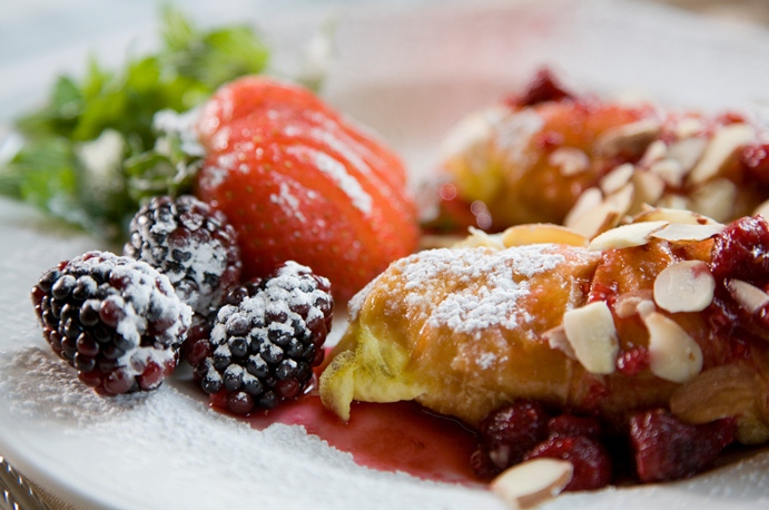 Raspberry French Toast for breakfast at Berry Manor Inn. Photo by Jumping Rocks Photography.