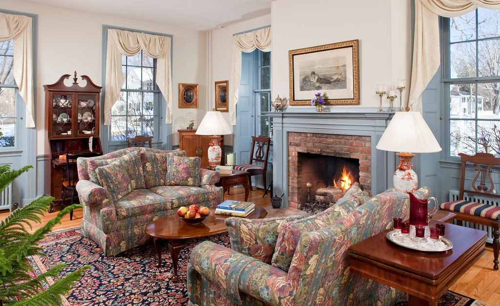 Fireside chats and relaxing happen in the common rooms at Inns Along the Coast. Shown here: Captain Jefferds Inn. Photo by Jumping Rocks Photography.