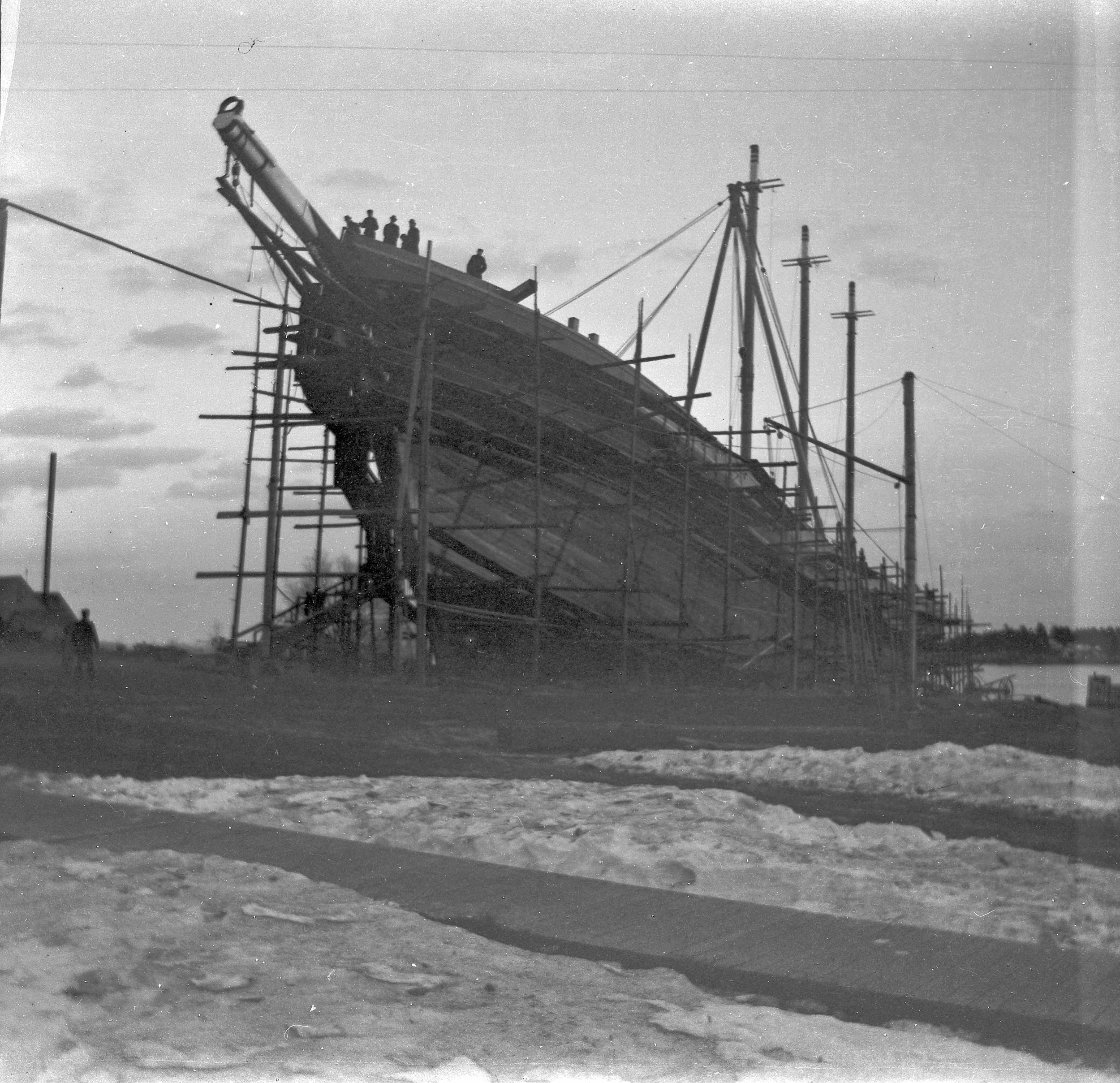 Construction of the 5-masted schooner John B. Prescott in 1898. The largest schooner in the world at that time, she was built to carry 4300 tons of coal. More than 10,000 people turned out for the launching at the Bean shipyard in Camden. The vessel was 282 feet long, weighing 2249 tons with masts 168 feet tall. The vessel was sheathed in iron to protect it from the ice. Photo courtesy of Camden Public Library