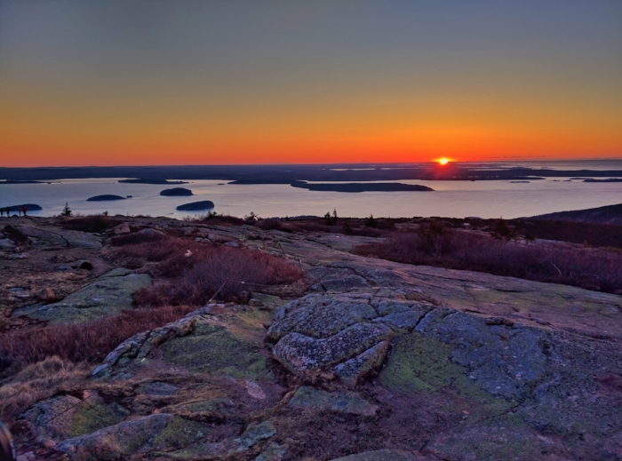 Sunrise from atop Cadillac Mountain in Acadia National Park. Photo by PJ Walter Photography.