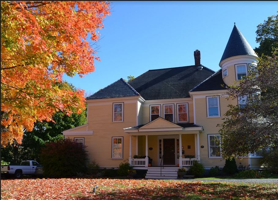 Falling leaves add a carpet of autumn colors to the Hawthorn Inn.