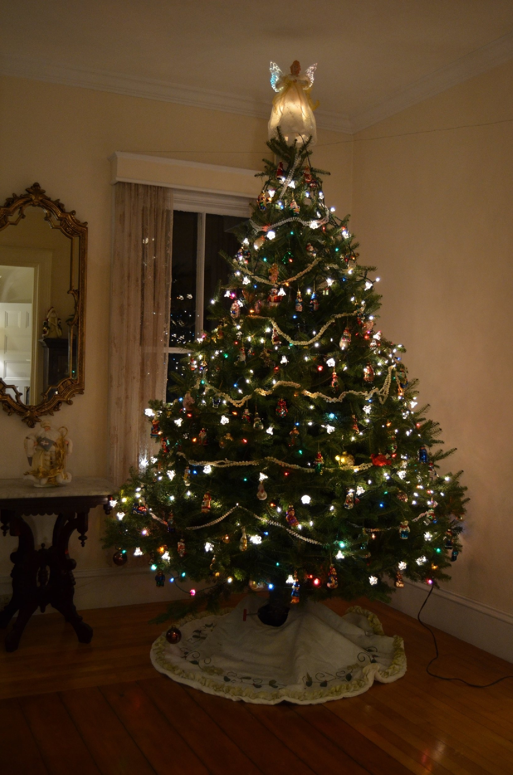 A colorfully lit tree graces the Parlor at Hawthorn Inn.