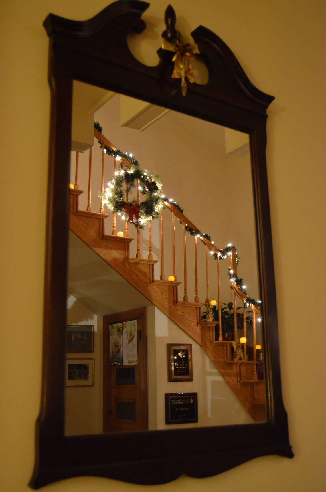 Even the grand hallway and staircase are decorated with lights and boughs.