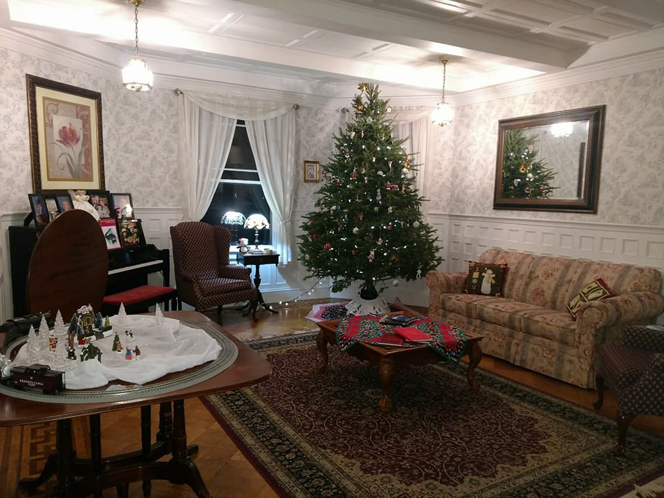 And the living room is aglow in red and green with a sparkling tree for all to see inside and out at Saltair Inn.