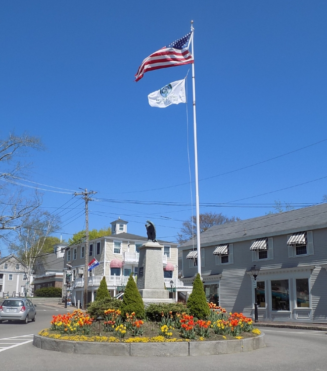 Tulips line the gardens at the base of the monument at Kennebunkport's Dock Square. Photo by Marti Mayne.