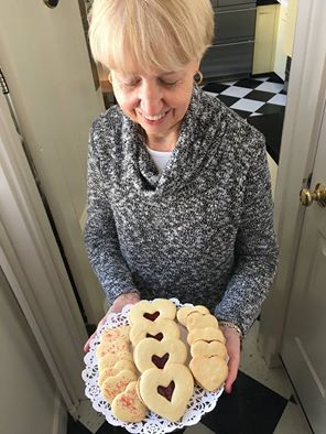 Sarah, innkeeper at the Captain Jefferds Inn, serves homemade cookies to guests each afternoon.