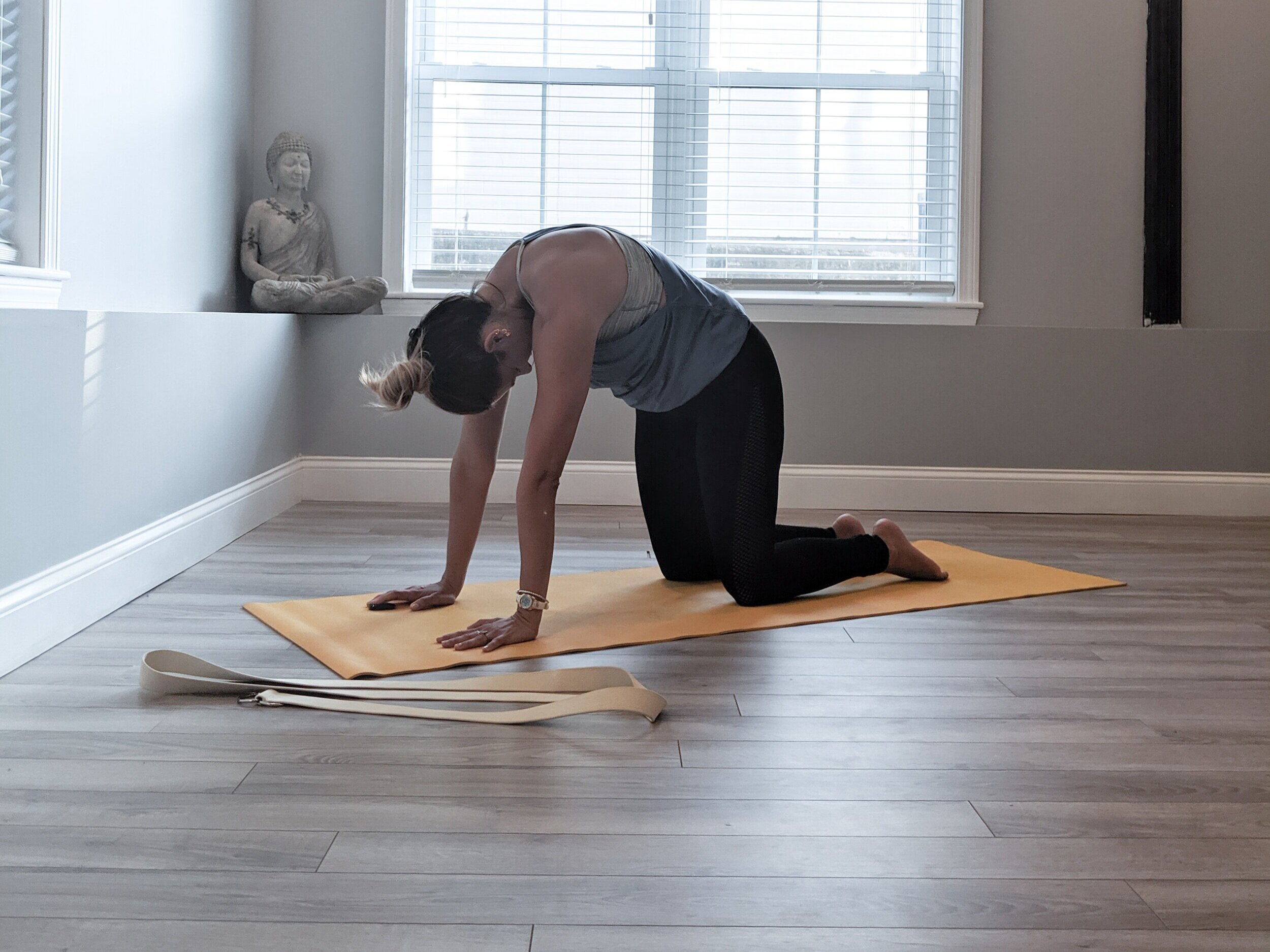 3. Cat pose - From cow pose, begin to round the spine as you exhale coming in to cat pose. Bring your chin to chest and find space in the shoulder blades. Follow the breath and come back into cow, repeat this for a few rounds of breath.