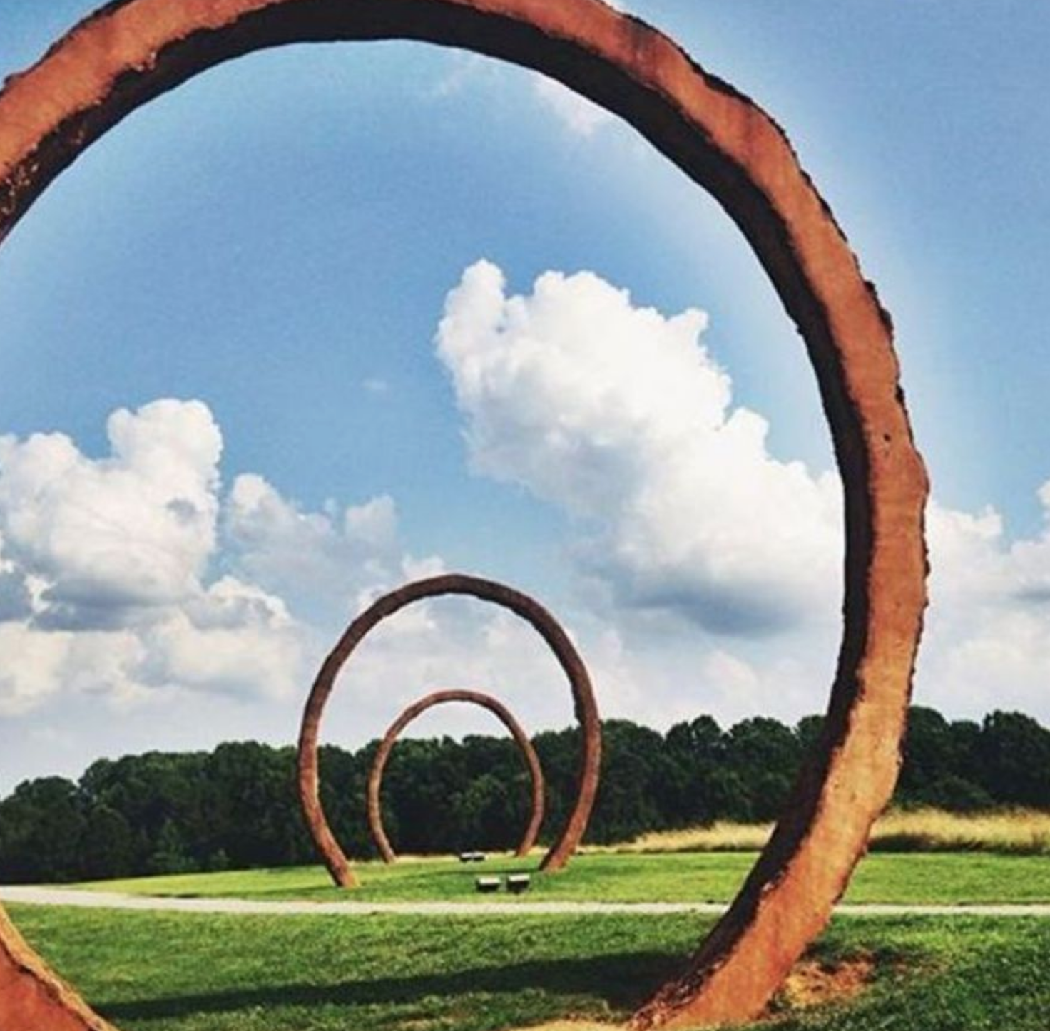 MASSIVE WORKS OF ART LINE THE GREENWAY BIKE TRAIL AT THE NORTH CAROLINA MUSEUM OF ART.