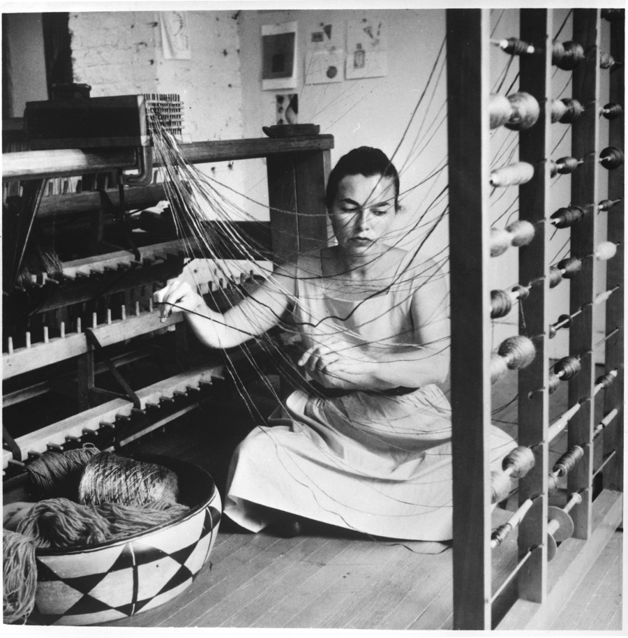 Lenore Tawney in her Coenties Slip studio, New York, 1958, Photo by David Attie, Courtesy of Lenore G. Tawney Foundation.