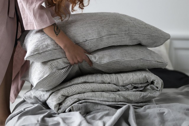 Making the bed was never so much fun.  Organic linen bed sheets  in black and white pin strip.