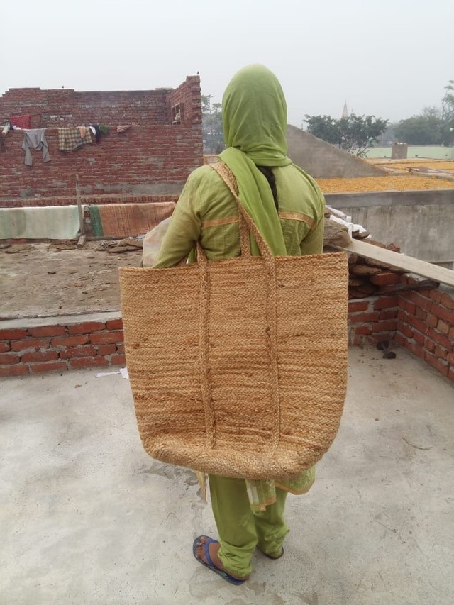 Oversized jute  handwoven laundry basket . Never thought we'd be excited for laundry, yet here we are.