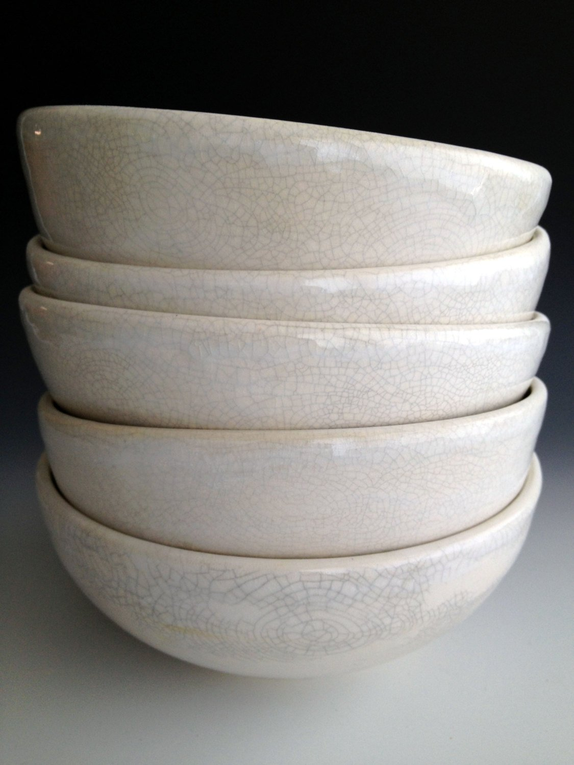 Stacked crackle  hand thrown bowls , make everything we eat more beautiful. Hand made on Martha's Vineyard.