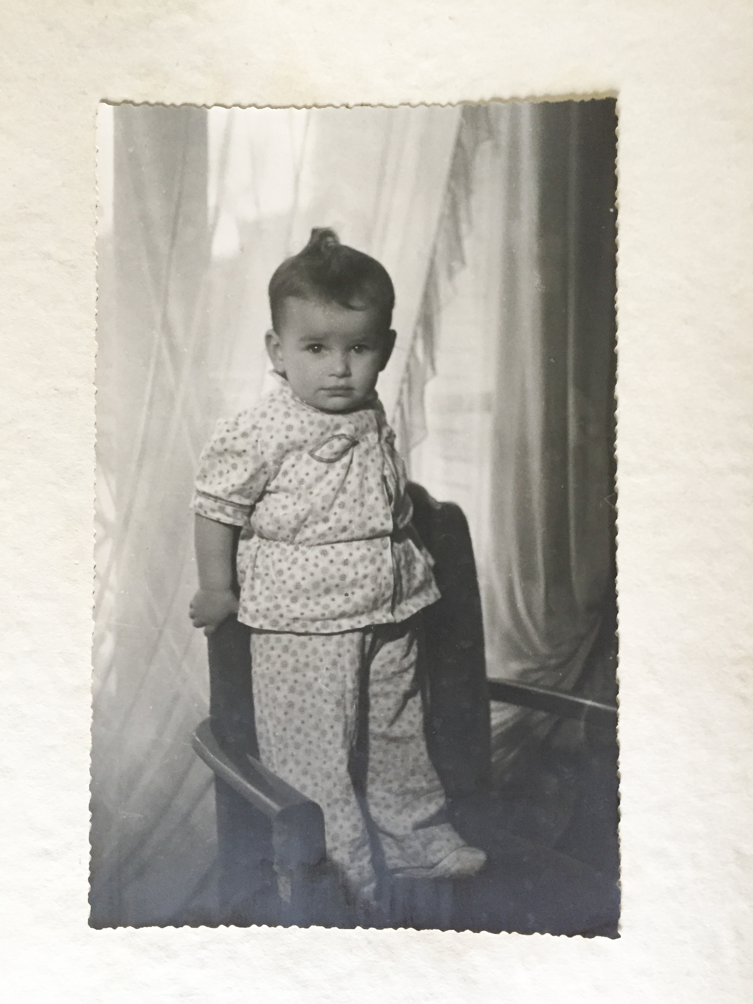 Janine Janowski pictued at 1-year-old in her home in Paris, France.(Photo:Muriel Hasbun archive.)