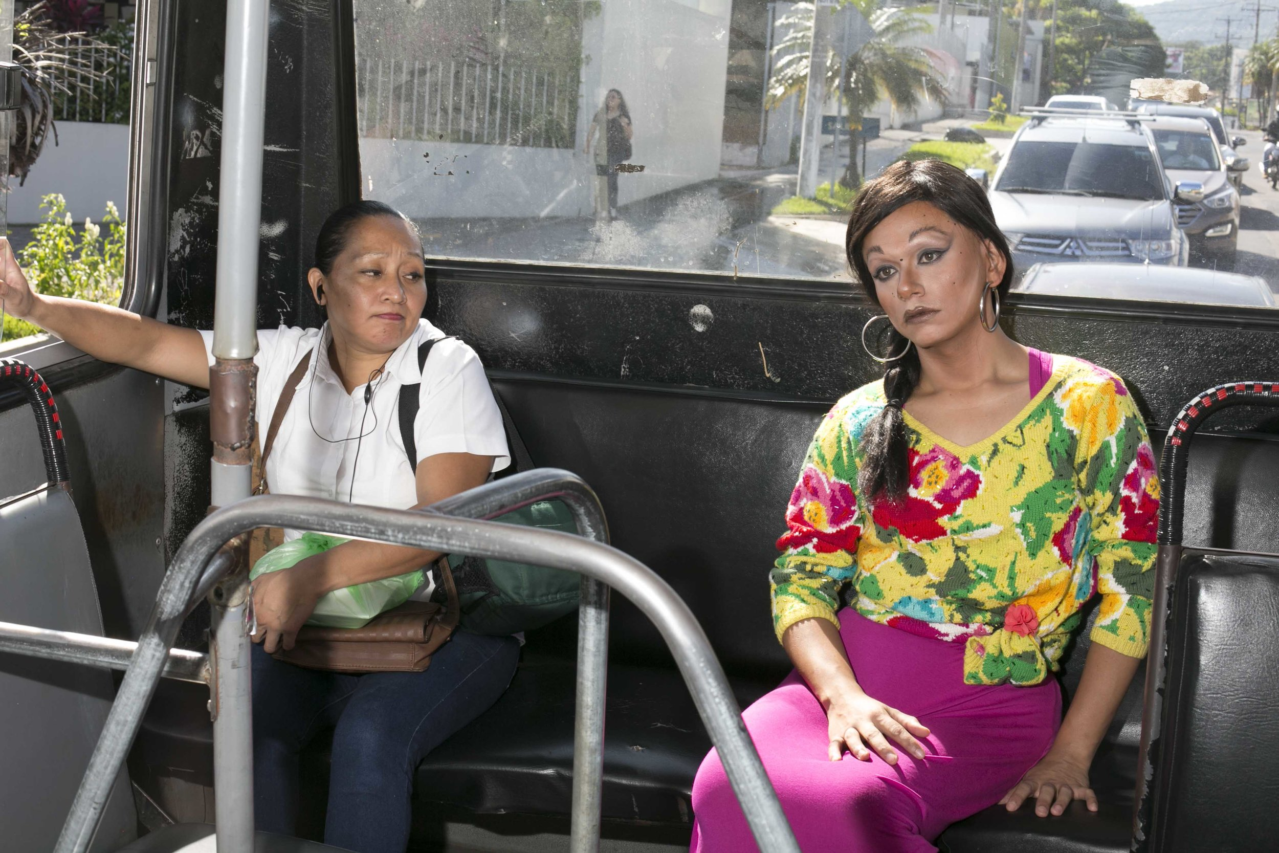 "Riding the bus in drag is extremely dangerous for NadiA but it's her only means of transportation. ""One time I was in the bus in the clothes of a boy and that man feel so threatened from my pink socks he show me the knife. He wasn't even bad guy, he just scare,"" Nadia said. When this happened NadiA was dressed in boys' clothes. It was only a little pair of pink socks that incited that reaction in him. ""This is the hard part,"" she said, ""they don't can understand."" El Salvador has suffered an increase in violence against members of the LGBTQIA community, especially those who are transgenders or transsexuals."